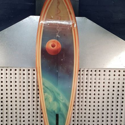 Terry Fitzgerald Hot Buttered single fin with a Martin Worthington space spray on it